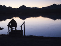 Angler silhouette at the bavarian Lake near