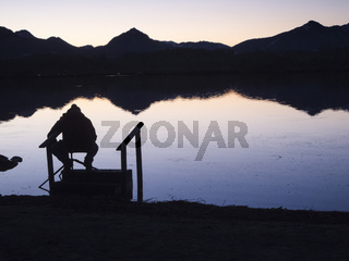 Angler silhouette at the bavarian Lake near