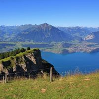 Stunning view from Mount Niederhorn. Azure blue Lake Thun and Mount Niesen Bernese Oberland, Switzer
