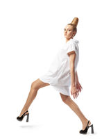 Beautiful spectacular blonde lady with an unusual high hairdo on a white background
