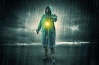Man walking in storm with lantern