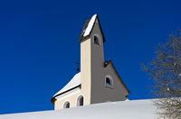 San Maurizio chapel at Passo Gardena, Gardena Pass, in winter, Sella region, Dolomites, Italy