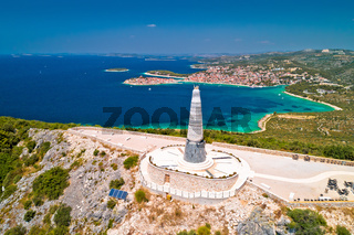 Giant Virgin Mary statue on hill above Primosten aerial view