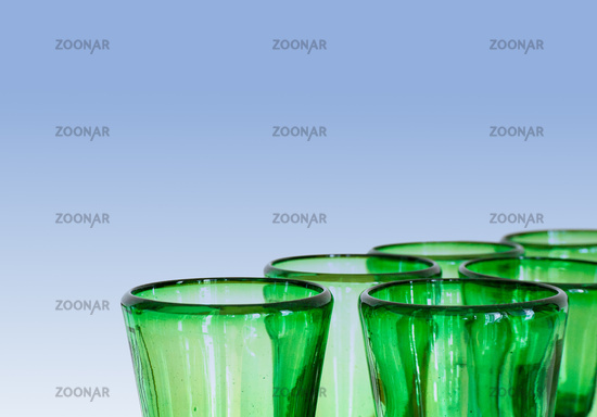 green glass designer wine glasses detail view abstract with copy space