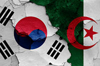 flags of South Korea and Algeria painted on cracked wall