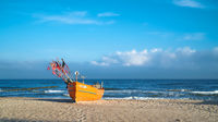 Fishing boat on Baltic sea beach at Rewal in Poland