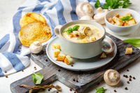 Chicken cream soup with mushrooms.
