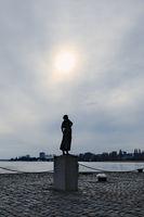 Antwerp, Belgium - March 18 2018: Silhouetted female statue near the river Scheldt