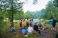 Hiking and camping of young people, group of tourists around the campfire