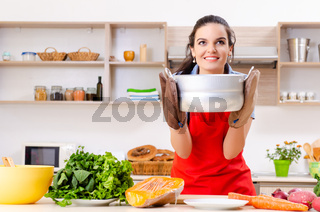 Young woman with vegetables in the kitchen