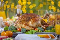 Roasted turkey on festive table for Thanksgiving celebration