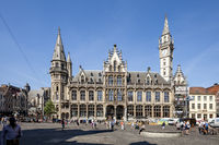 Ghent, Belgium - June 1, 2017: The old post building across the Saint Nicolas Church in the center of town