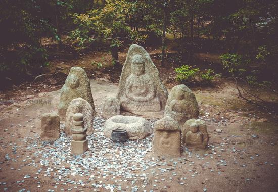 Statue in Kinkaku-ji temple garden, Kyoto, Japan