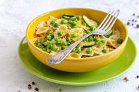 Traditional pasta with green peas and zucchini.