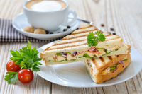 Pressed panini with a cappuccino