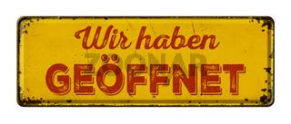 German words  Wir haben geöffnet ( We are open) on a vintage rusty metal sign