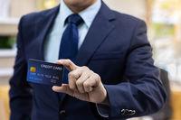 Businessman hold credit card