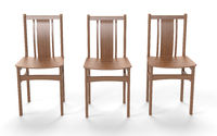 Several old style chairs on the white background.