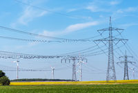 Power supply lines and some wind turbines seen in Germany