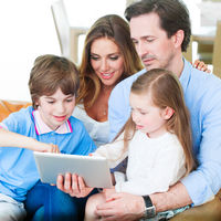 Happy family with tablet pc