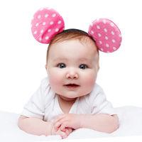 funny little baby girl in mouse ears headband