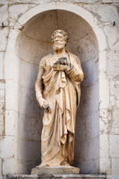 ancient stone Saint Peter statue at Assisi Marche Italy