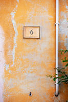 orange painted wall with the number six