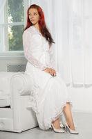 Lovely redhead woman posing in studio.