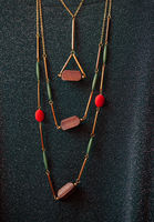 costume jewelry made of wood against the guipure