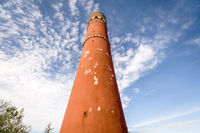 Tall red round tower heading to the sky