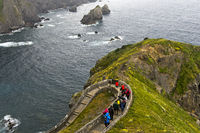 Zigzag trail above the Bay of Biscaya on the islet of San Juan de Gaztelugatxe, Bakio, Spain