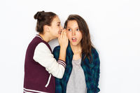 teenage girls gossiping or sharing secrets