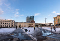 Oslo, Norway - March 16, 2018 - Oslo Central Station, day, people walking, snow on the ground.