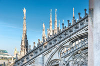 Marble statues - architecture on roof of Duomo cathedral