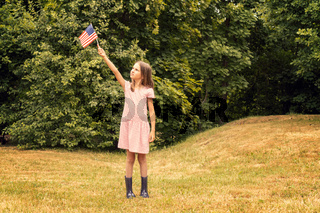 Child girl with small american flag