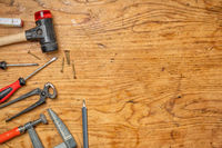 Woodworking tools on a wooden background with copy space