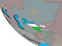 Uzbekistan with flag on 3D globe