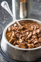 Meal for dog or cat. Canned meat with sauce.