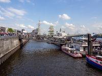 View at crowded landing bridges in Hamburg harbor at Harbors Birthday.