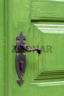 Old green wooden door and door handle