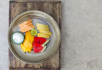 Platter with watermelon, mango, pineapple, lime, melon and icecream