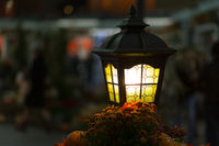 close-up  yellow lantern glows yellow. street lighting. Creating cozy romance  bright lamp with copyspace on  blurred background