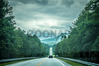 driving through table rock park mountains in south carolina