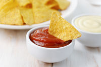 Nachos chips with ketchup