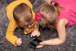 Children watching cartoons on a smartphone