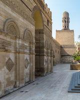 Entrance of public historic Al Hakim Mosque - Enlightened Mosque - and Minaret, Moez Street, Cairo