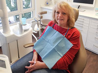 Blond woman is sitting in the dentists chair