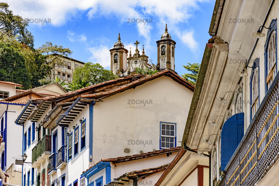 Colonial houses of Ouro Preto city with church in background