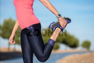 woman doing stretching exercise for legs, sport background.