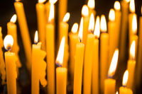 Many burning candles in church in Venice